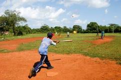 Boys playing baseball on a field at Las Galeras Royalty Free Stock Photos