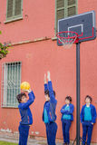 Boys playing basketball. Actually the same guy cloned royalty free stock photography