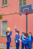 Boys playing basketball. Actually the same guy cloned in a multiplicity royalty free stock image