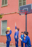 Boys playing basketball. Actually the same guy cloned in a multiplicity royalty free stock photography