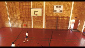 Boys playing basketball in court stock footage