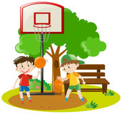 Boys playing basketball in the park Royalty Free Stock Image