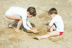 Boys playing on the beach .Children playing on the beach. Boys playing on the beach. Children playing on the beach with the sand royalty free stock image