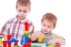 Boys playing with blocks Stock Photos
