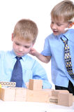 Boys playing with bricks royalty free stock photos