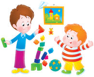 Boys playing with bricks Royalty Free Stock Images