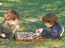 Boys Playing Checkers Stock Photos