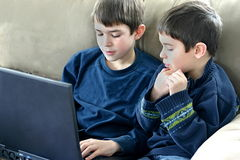 Boys Playing on Computer Royalty Free Stock Images