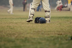 Boys are playing cricket stock photo