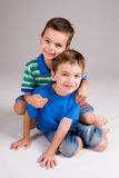 Boys playing on floor Royalty Free Stock Images