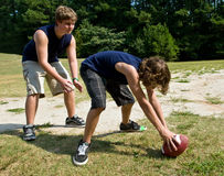 Boys playing football Stock Images