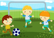 Boys playing football. Illustration about 3 cute little boys playing soccer on the grass Stock Image