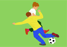 Boys playing football Stock Photo