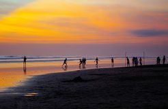 Boys playing football on beach Stock Images
