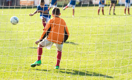 Boys playing football soccer game on sports field Royalty Free Stock Photos