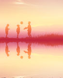Boys playing football at sunset. silhouette concept Royalty Free Stock Images
