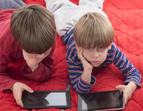 Boys playing games on tablet computers Royalty Free Stock Photography