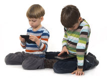 Boys playing games on tablet computers Royalty Free Stock Photo
