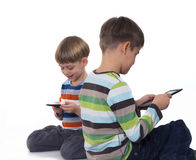 Boys playing games on tablet computers Stock Images