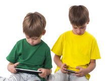 Boys playing  games on the tablet computers Stock Images