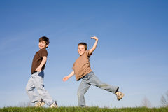 Boys Playing on a Hill. Two Boys Playing Up on a Hill Royalty Free Stock Photography