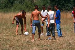 Boys playing in Kosovo royalty free stock images