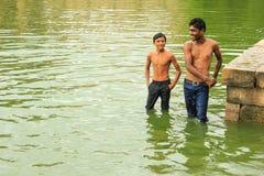 Boys playing in lake, Ahmedabad, India. stock photo