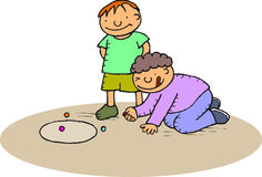 Boys playing marbles. Two boys playing with marbles at the ground Royalty Free Stock Image