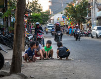 Boys Playing with Marbles. In the streets of Labuan Bajo, Flores stock images