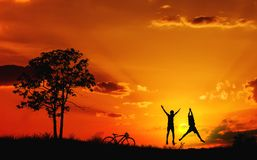 Boys playing in meadow field on sunset time. royalty free stock image