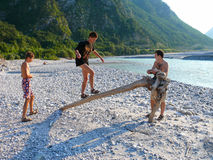 Boys playing near Fella river, Northeast Italy Royalty Free Stock Image