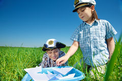 Boys playing with paper boats Royalty Free Stock Photography