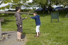 Boys playing in park Royalty Free Stock Image