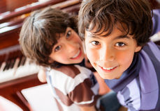 Boys playing the piano Stock Image