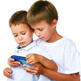 Boys playing portable video game. Two brothers playing portable video game Stock Photos