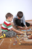 Boys playing the puzzle Royalty Free Stock Image