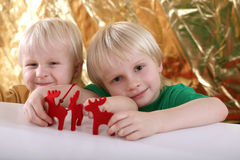 Boys playing with reindeer Stock Photo