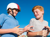 Boys Playing Rock, Paper, Scissors On The Santa Monica Pier. Best friends playing the game Paper, Rock, Scissors on the Santa Monica Pier in Santa Monica Stock Image