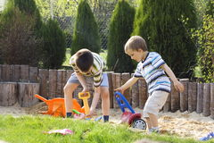 Boys playing in sand Stock Photos
