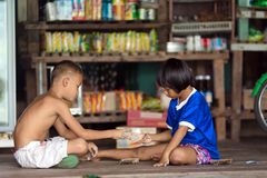 Boys playing scissor rock paper game Royalty Free Stock Image