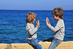 Boys playing by the sea Royalty Free Stock Images