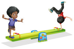 Boys playing on seesaw Royalty Free Stock Photo