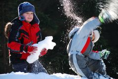 Boys playing in snow. Two boys (brothers) playing in snow Stock Photo