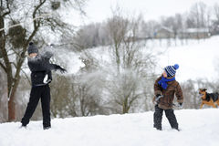 Boys playing snowballs Royalty Free Stock Photo