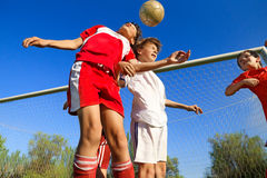 Boys playing soccer. Little Boys playing soccer on the sports field next to goal Stock Photography