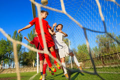 Boys playing soccer. Little Boys playing soccer on the sports field next to goal Royalty Free Stock Photos