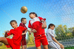 Boys playing soccer. Little Boys playing soccer on the sports field next to goal Royalty Free Stock Photo