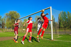 Boys playing soccer. Little Boys playing soccer on the sports field next to goal Stock Images