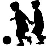 Boys Playing Soccer. Silhouette vector of two boys chasing a soccer ball Royalty Free Stock Photos