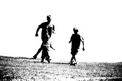 Boys playing soccer. Three boys playing soccer in silhouette Royalty Free Stock Images